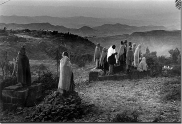 Thousands of Christians pilgrimate to Lalibela, its a religious promise that Ethiopian Orthodox  must do  at least once  before dying. Most of them are very poor farmers coming from isolated areas on foot during days, weeks passing hunger and cold nights at open air.