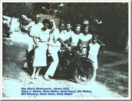 Uncle Harry Weber and Ray's cousins pose on his motorcycle.