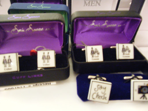 This photo came out a little blurry, but I thought the cufflinks featuring the wedding couple and ushers were so adorable.