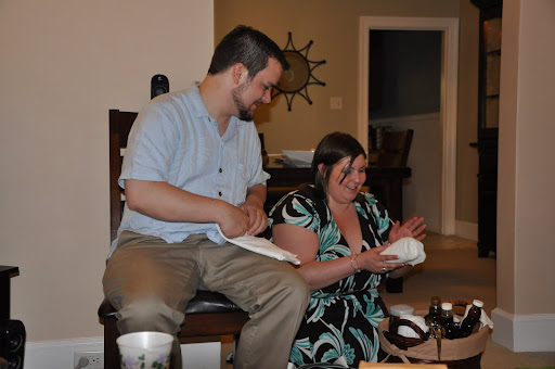 Corey and Jodi open a wedding present.