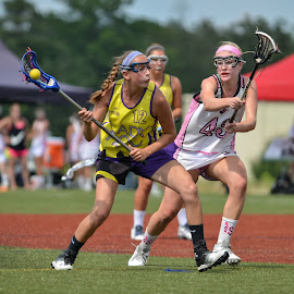 She shoots by Keith Kijowski - Sports & Fitness Lacrosse