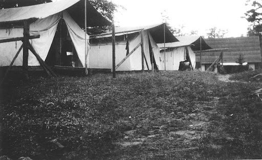 Even the tents look pretty luxurious. Raquette Lake Camp, c. 1910. (