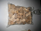A bag of our wooden candlestick holders. Waiting to be sprayed.