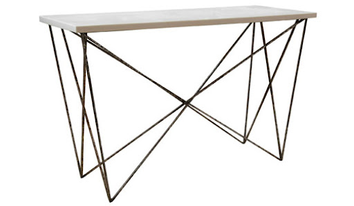 Another great example of a modern yet approachable entryway table. It's almost a piece of sculpture for your foyer. (olystudio.com)