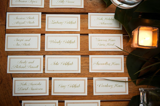 Calligraphed escort cards helped guests find their seats.