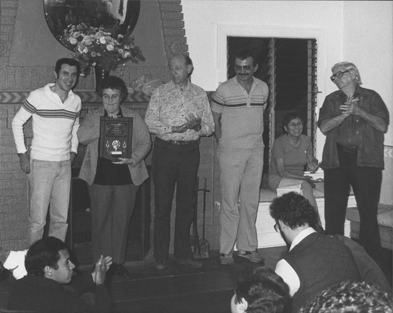 Previous winners of the Judy Coleman Memorial Award prepare to present the award. People include (standing, left to right) Pat Rocco, Ivy Bottini, W. Dorr Legg, Frank Vel, and Morris Kight. 1982.