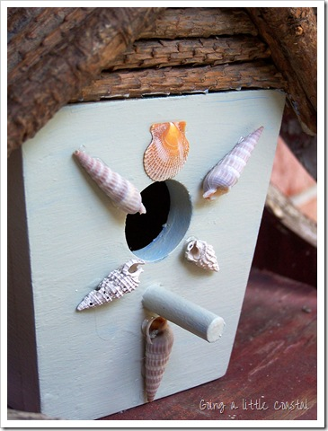 coastal birdhouse with shells