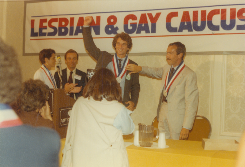Robert Kennedy Jr.(with arm raised) addresses the Lesbian & Gay Caucus at the 1980 Democratic National Convention in New York City. August 11- 14, 1980.