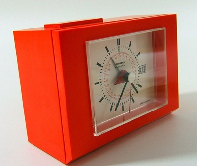 Remington R24 Sperry Rand battery operated orange plastic clock