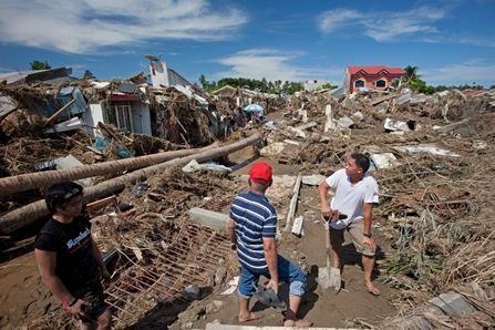 18IGNFLOOD5<br />Residents of the Orchid Homes Subdivision in Barangay Santiago survey the damage Sunday Dec. 18, 2011 a day after flashfloods brought about by Typhoon Sendong hit Iligan City. MindaNews photo by Bobby Timonera<br />