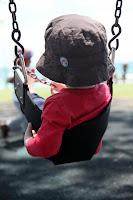 Oscar on the swings at Byron Bay