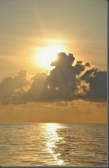 sunset open ocean circumnavigating by sailboat 2