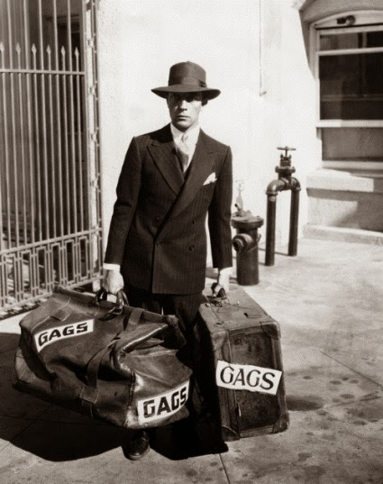 1928: Buster Keaton, the glum-faced comedian, arrives at Metro-Goldwyn-Mayer studios with two large bags of his comic ideas. Keaton will make five films a year for MGM release.