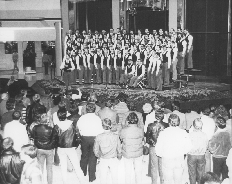 The Los Angeles Gay Men's Chorus performs at the Beverly Center. Circa 1979.