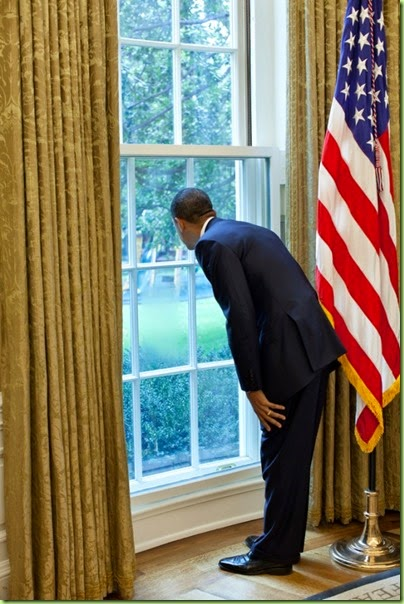 president-barack-obama-looks-out-a-window-in-the-oval-office-at-first-lady-michelle-602x902