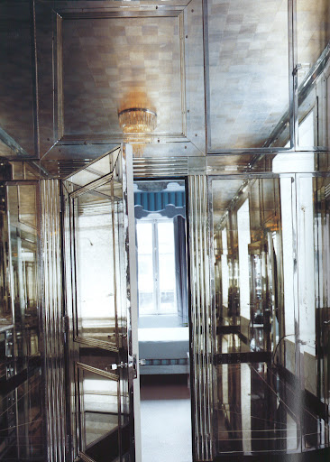 An extraordinary mirrored dressing room articulated with fluted pilasters, designed for meatpacking baron Lester Armour by architect David Adler, is now installed in the New York town house of Miles Redd. (Regency Redux, Rizzoli)
