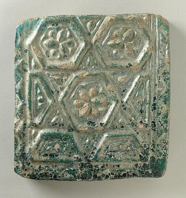 Tile | Origin: Iran | Period:  12th-13th century (?) | Collection: The Madina Collection of Islamic Art, gift of Camilla Chandler Frost (M.2002.1.287) | Type: Ceramic; Architectural element, Earthenware, molded and glazed, 7 1/4 x 7 1/4 in. (18.41 x 18.41 cm)