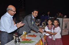 Mr. Suhas Naik giving away prizes