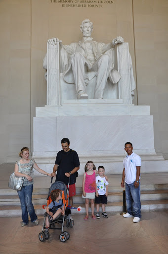 Natalie and Eli strike a pose in front of Lincoln.