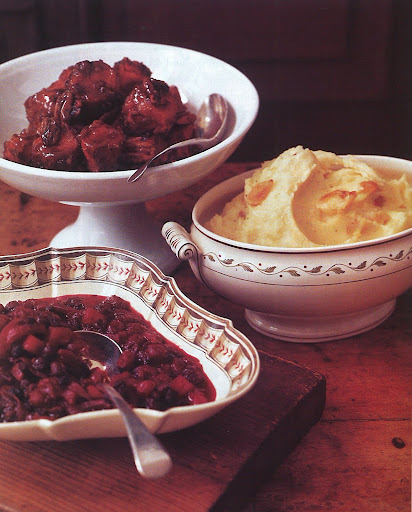 The side dishes include baked sweet potatoes and pecans, roasted-garlic mashed potatoes, and chunky apple-cranberry sauce.
