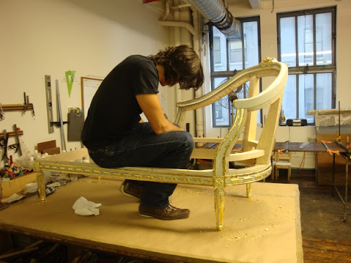 Christophe is hard at work in his studio bringing life and intricacy to this elegant chaise frame.