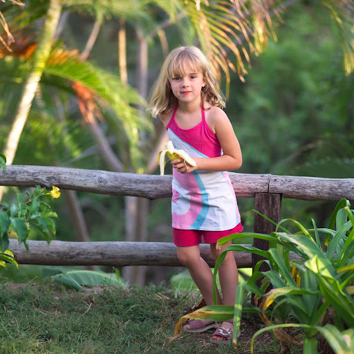 crls700040 jpg six year old girl holding a banana tags 6 year old ...