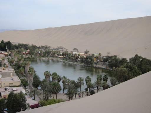 The natural oasis of Huacachina, surrounded by enormous sand dunes