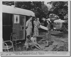 Census enumerator visiting a trailer park