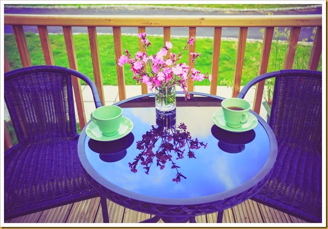Table setting with tea cups on porch