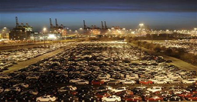 Mercedes cars at a shipping terminal in the harbor of the German northern town of Bremerhaven, 8 March 2012. Germany's economy crept back into growth at the start of 2013 but not by enough to stop the euro zone from contracting for a sixth straight quarter, and France slid into recession. Photo: Fabian Bimmer / REUTERS