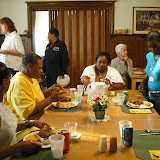Dinner time during a women's retreat at Anglea House in 2010