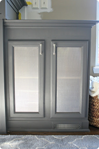 How to add metal sheeting to cabinet doors from Thrifty Decor Chick