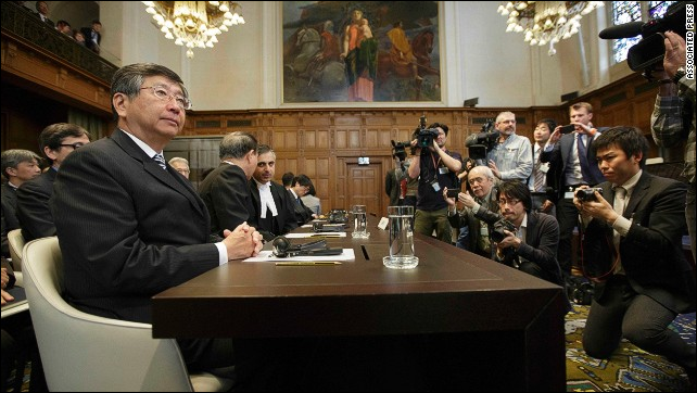 Japanese Ambassador to the Netherlands, Koji Tsuruoka, waits for the verdict in The Hague, Netherlands, on 31 March 2014. The International Court of Justice ruled that Japan can no longer continue its annual whale hunt, rejecting the country's argument that it was for scientific purposes. Photo: AP