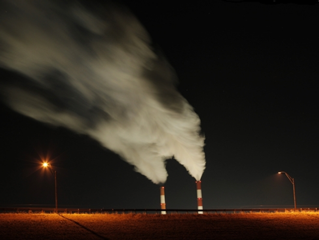 Smoke rises from the stacks of the La Cygne Generating Station coal-fired power plant in La Cygne, Kansas, on 19 January 2013. The Natural Resources Defense Council, an environmental group, urged President Obama to limit the greenhouse gas emissions from all power plants -- not just new ones as the Environmental Protection Agency has proposed. Photo: Charlie Riedel / AP