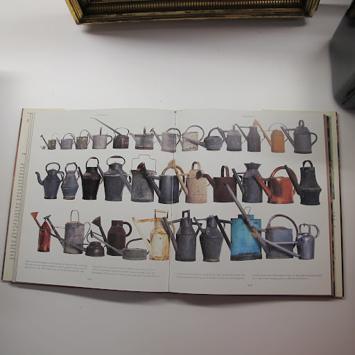 Spread out across two pages, this collection of watering cans looks quite impressive.