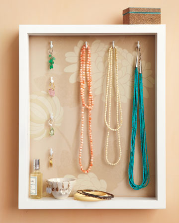 This basic shadowbox becomes a great jewelry holder when fitted with decorative paper and hooks.