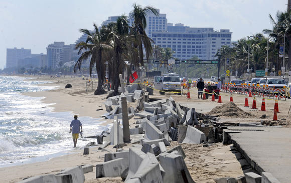 Barricades line the beach next to crumbling sidewalks and seawalls along State Road A1A just north of Sunrise Blvd, 26 November 2012. Photo: Susan Stocker / Sun Sentinel