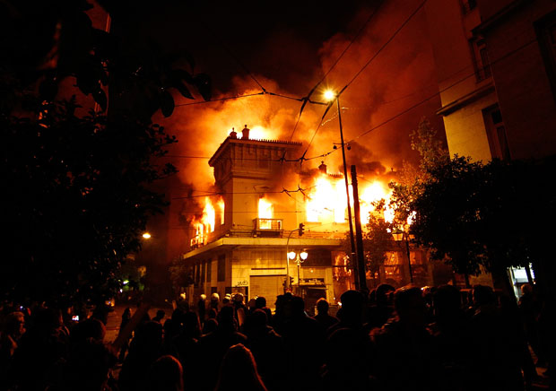 A building in Athens is engulfed in flames during the demonstration against Greece's new austerity measures, 12 February 2012. Vladimir Rys / Getty Images