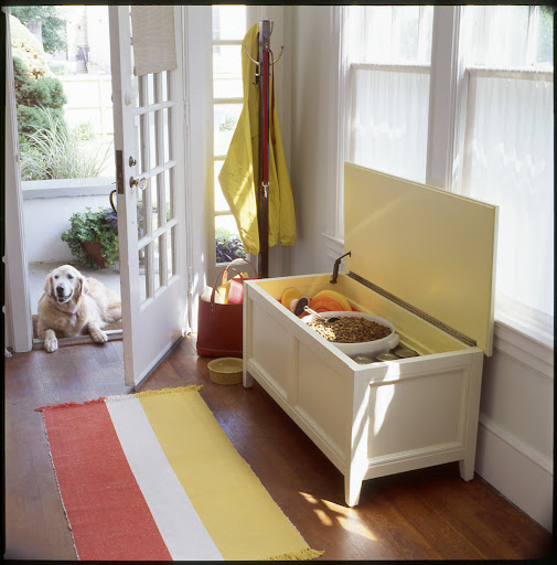 A flip top storage bench in an entryway or mudroom is the perfect place for storing pet food and supplies plus it give you a place to sit when putting on and taking off shoes.