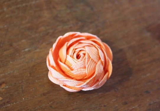 Unfurling the petals to a full rose - How To Make Ric-Rac Rose Jewelry | Lavender & Twill