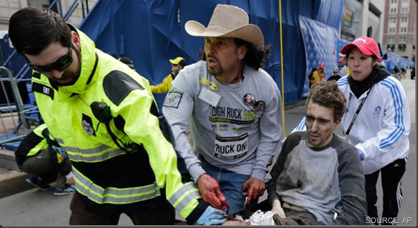 Paramedics and Carlos Arredondo (in cowboy hat) lead a gravely wounded Jeff Bauman away from the blast site. CLICK for more coverage.