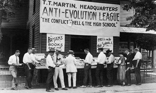 An anti-evolution league holds a book sale at the opening of the Scopes 'monkey' trial in 1925, when a Tennessee public school teacher was convicted and fined for teaching evolution. Corbis