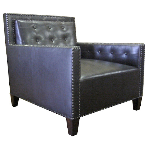 I love the classic shape of this studded club chair - perfect for the library.  Not sure if I would keep the leather upholstery, however.
