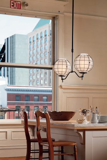 The Rockwell industrial fixture is based on gas fixutures that were used in American factories but Rejuvenation's new electrical version looks right a home over a kitchen island.