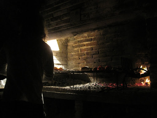 Working the wood-fired grill at our hostel's asado night.
