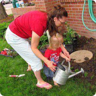 Elaine planting flowers