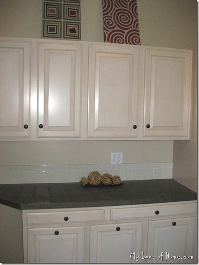 Maple cabinets, brown counter top, DIY art