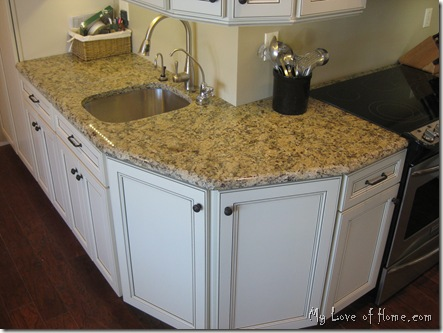 white cabinets, granite new venetian gold