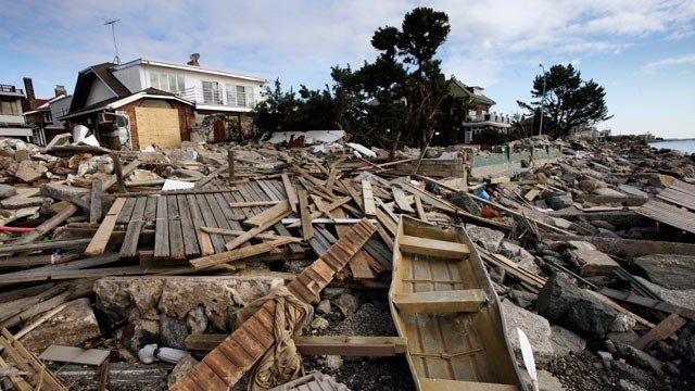 Debris sits in front of a beachfront home in the Manhattan Beach neighborhood of the Brooklyn, 5 November 2012, in New York. Mark Lennihan / AP Photo
