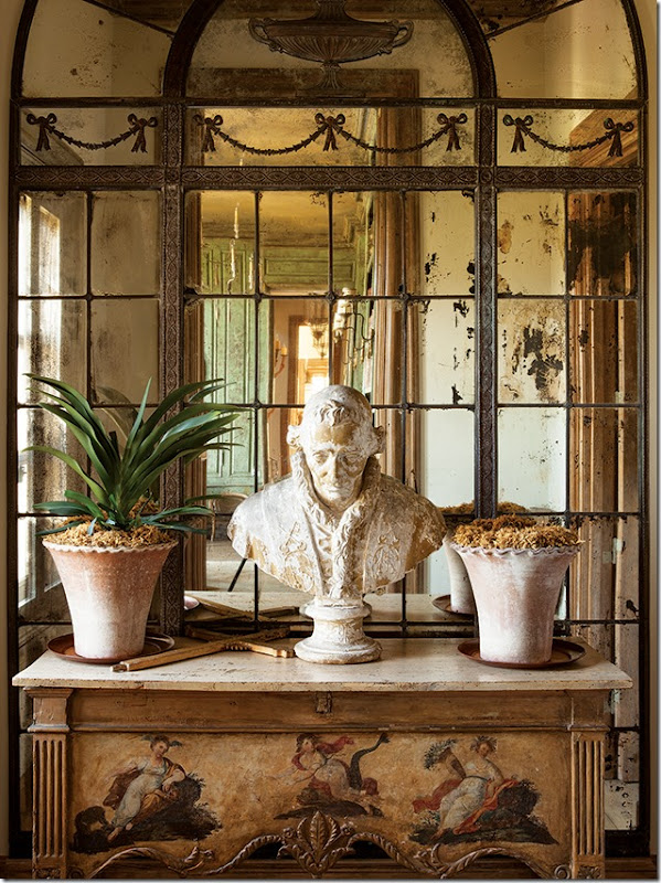 mirrored room with marble bust